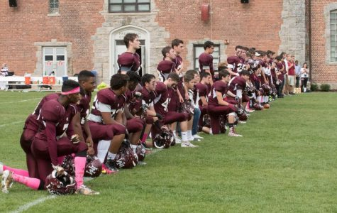 Football players kneel during national anthem