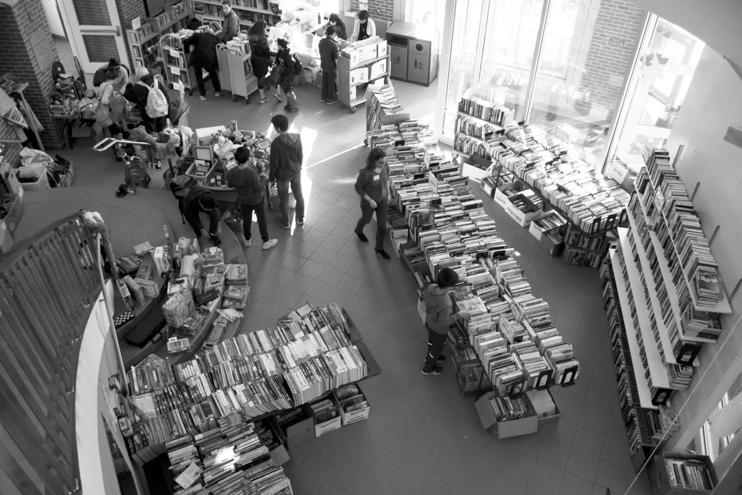 BOOKS WHERE?: Community browses the Book Fair at Fisher Rotunda.