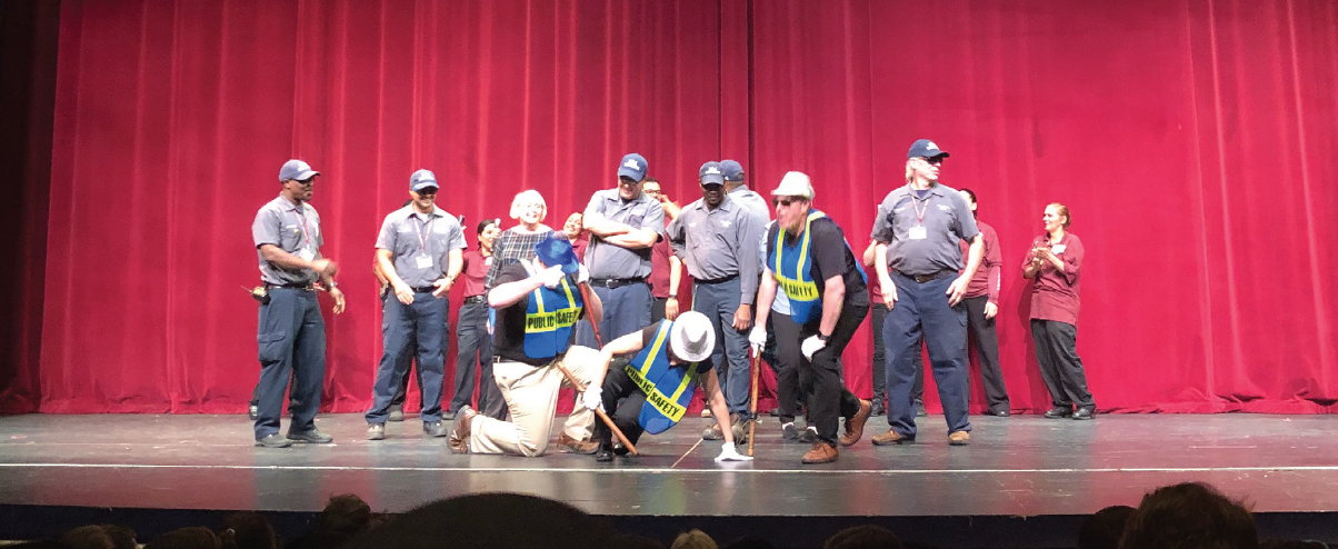 STOLE THE SHOW Maintenance, security, and FLIK staff dance in showcase assembly on Tuesday, May 22.