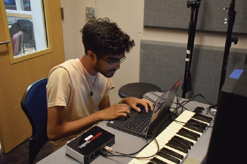 Arjun+Swarup+hard+at+work+on+beats+in+the+Music+Studio.