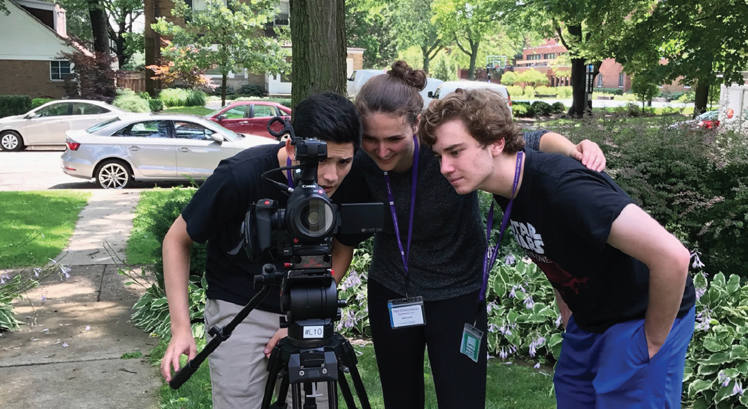 LIGHTS, CAMERA, ACTION Maggie Brill (12) (center) directs film at a Northwestern program.