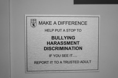 School targets bullying with bathroom signs