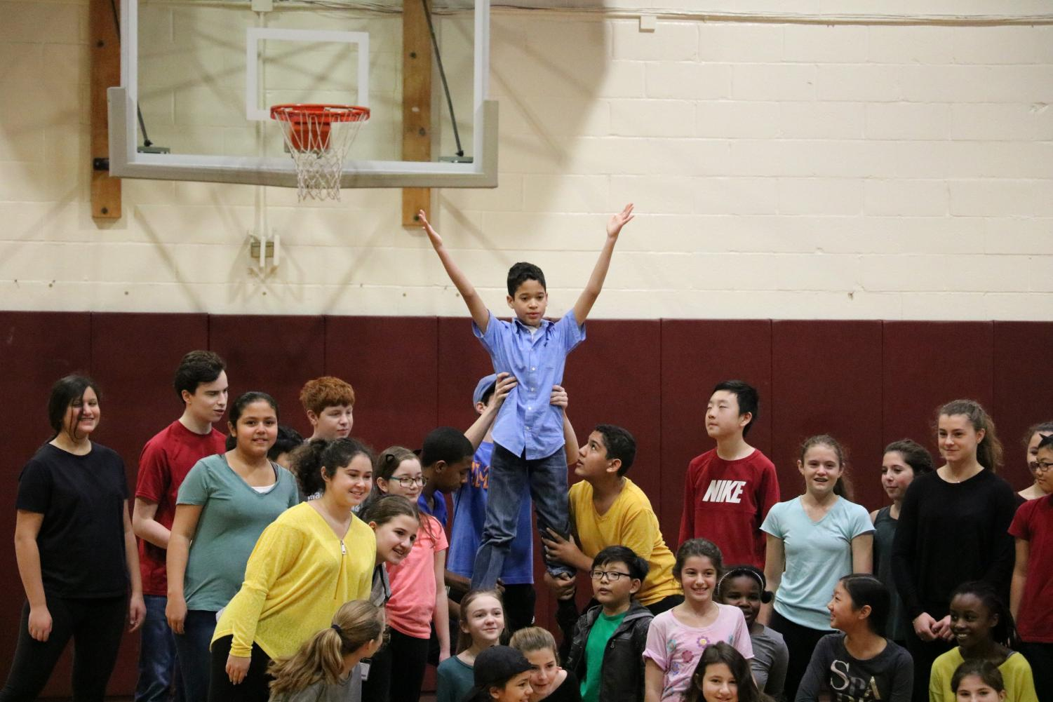 13: MD students perform 13! the Musical at the Lower Division, lifting up Matthew Aponte (8).