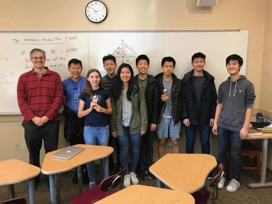 A SINE OF A GOOD TEAM: Math Team pose with trophies after PUMaC.