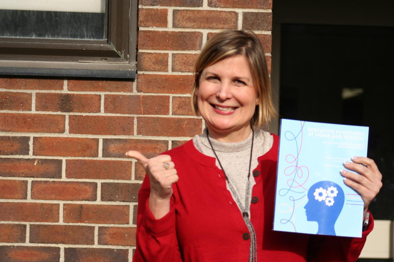 EXAMINING EXECUTIVE FUNCTION: Nichols poses with recently published book.