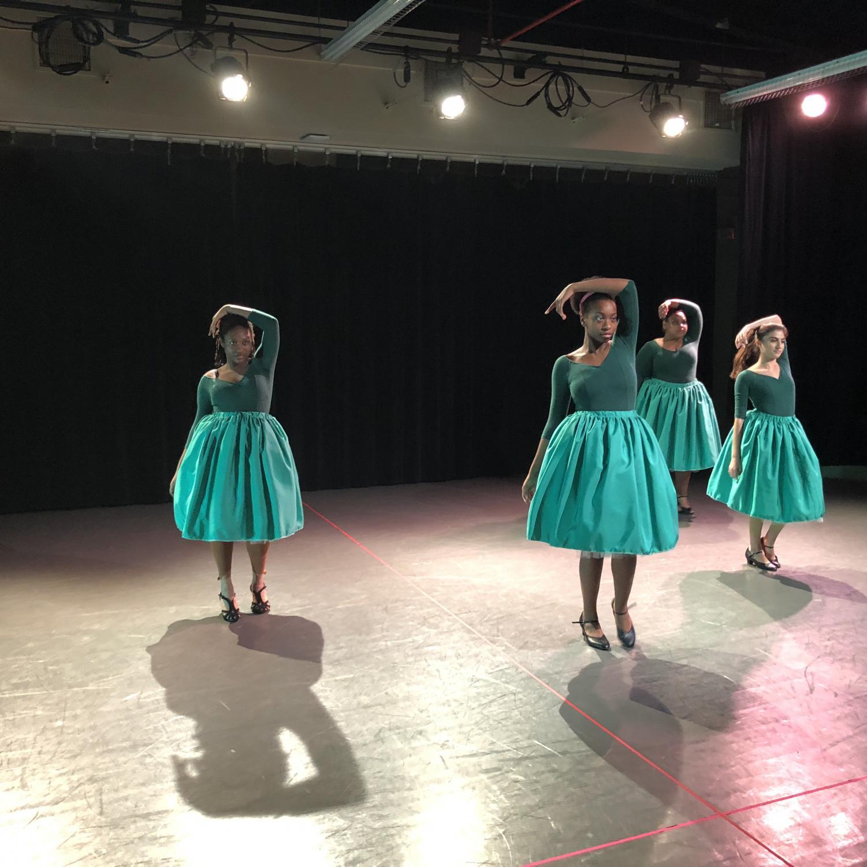 Damali O'Keefe (12), Akida Joseph (11), Arriana Serrano (12), and Allison DeRose (11) perform in