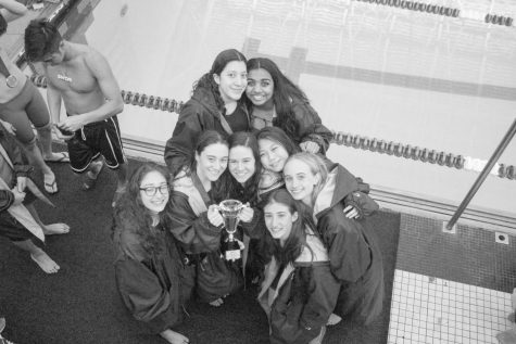 Girls varsity swim team ends undefeated season with a splash