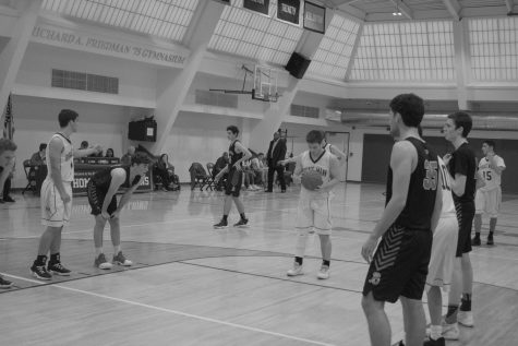 Boys Varsity Basketball splits games against Packer and Browning