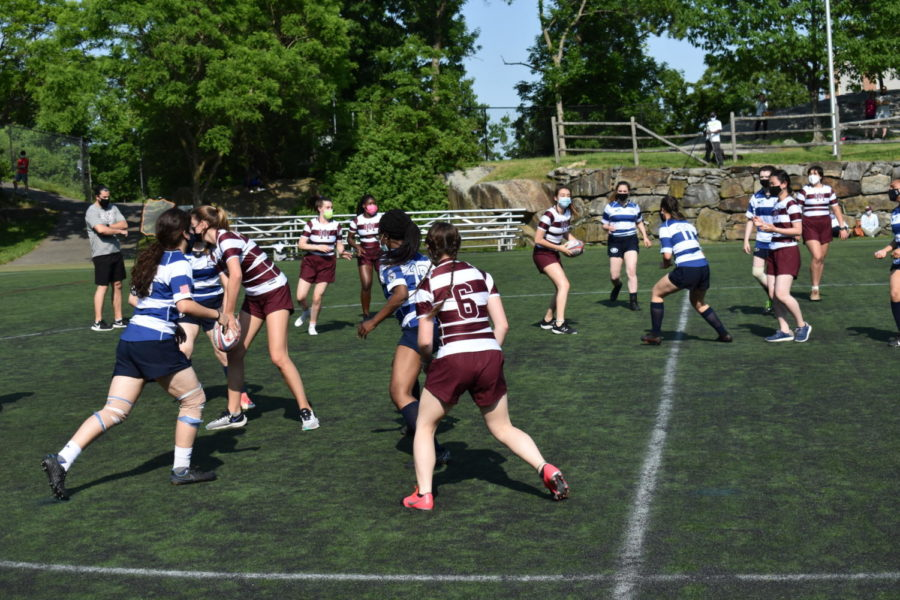 Girls rugby team goes undefeated against Harvey
